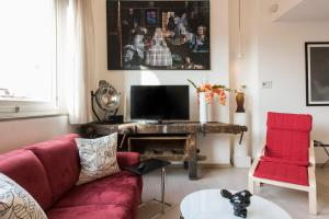 Een TV en/of entertainmentcenter bij Florence Art Apartments