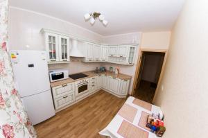 A kitchen or kitchenette at ATLANT Apartments 57
