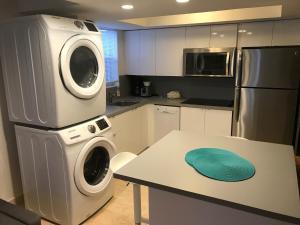A kitchen or kitchenette at Wave Beach Vacation Rentals