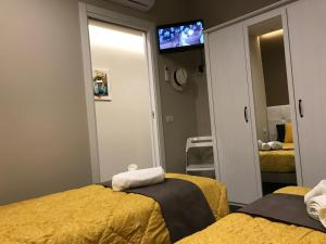 Cama o camas de una habitación en My Home