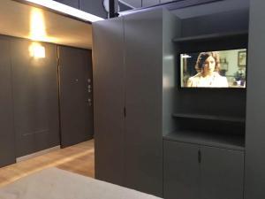 A television and/or entertainment center at Particolare Locale open space soppalcato