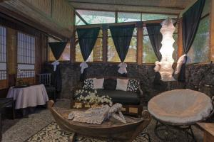 A seating area at The Bali House & Bali Cottage at Kehena Beach
