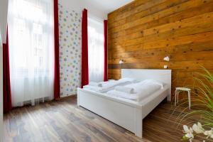 Ein Bett oder Betten in einem Zimmer der Unterkunft BPM-Magic Apartments at the Centre