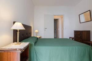 Cama o camas de una habitación en Miramar Apartments