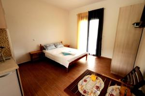 A bed or beds in a room at Alba Studio Thassos