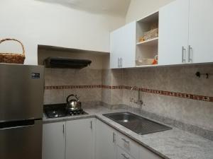 Una cocina o zona de cocina en Apartamento Centro Historico