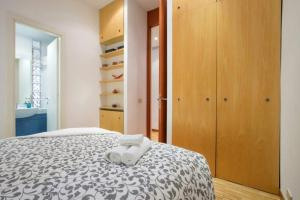 A bed or beds in a room at Trilussa Apartment Trastevere