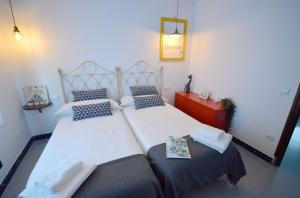 Cama o camas de una habitación en Ohana Apartamento Rural