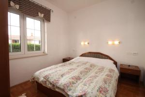 A bed or beds in a room at Apartment Jelsa 538c