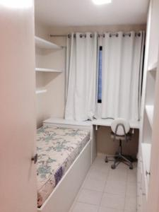 A bed or beds in a room at Flat Boa Viagem
