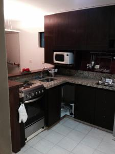 A kitchen or kitchenette at Flat Boa Viagem