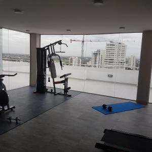 The fitness center and/or fitness facilities at Altos del Sur Apartments & Suites