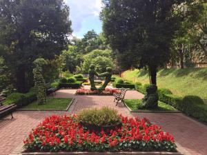 A garden outside Flat Prodigy Serrano Hotel