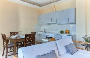 A kitchen or kitchenette at Nymphes Luxury Apartments