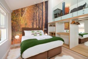 Een bed of bedden in een kamer bij Merino Hospitality
