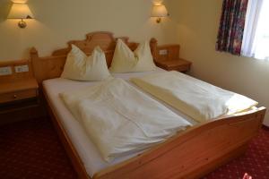 Ein Bett oder Betten in einem Zimmer der Unterkunft Holiday-Appartements