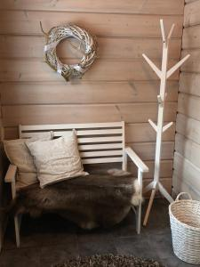 A bed or beds in a room at Arctic Villa @ Norvajärvi