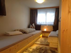 Ein Bett oder Betten in einem Zimmer der Unterkunft Ferienhaus Kathrili Gaschurn