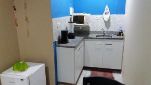 A cozinha ou cozinha compacta de Flat Htur - Porto De Galinhas