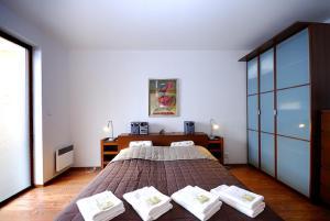 Postel nebo postele na pokoji v ubytování Apartments Ski & Sun