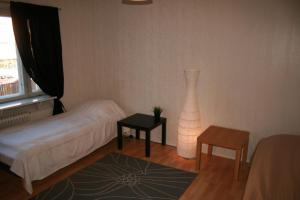 A bed or beds in a room at Twin bedroom apartment at the heart of Pori! (ID 2981)
