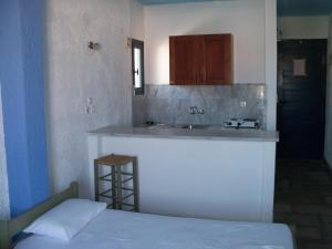 A kitchen or kitchenette at St George Studios & Apartments