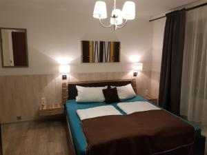 A bed or beds in a room at City Central Promenade