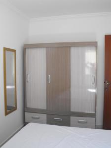 Cama o camas de una habitación en Residencial Vaz da Silva
