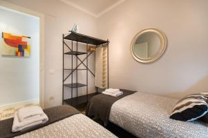 A bed or beds in a room at Barcelona 54 Apartment Rentals