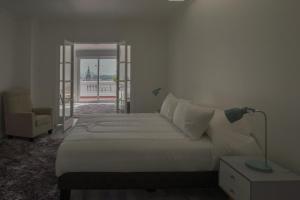 Cama o camas de una habitación en Downey Mozó Plaza de Armas