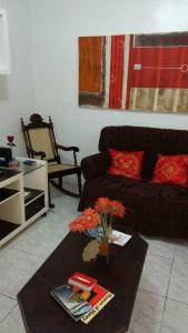 A seating area at Apartamento no Guará