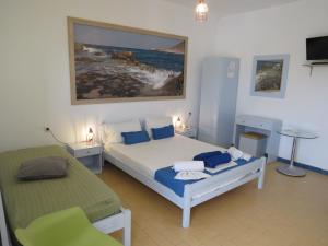 A bed or beds in a room at Blue Beach Villas Apartments