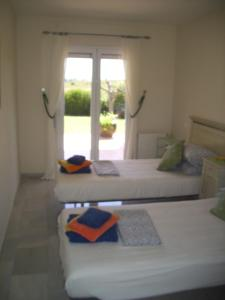 A bed or beds in a room at Super Villa with private Pool and Garden - Pilans