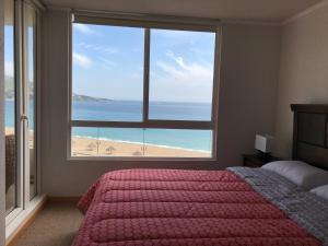 Cama o camas de una habitación en Departamento con salida a la playa