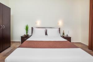 Cama o camas de una habitación en Belohorizonte Fine Accommodation