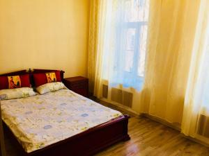 A bed or beds in a room at Квартира в Центре города