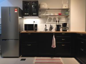A kitchen or kitchenette at Elegant Townhouse Setia Alam