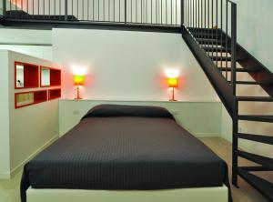 מיטה או מיטות בחדר ב-BB Hotels Aparthotel Città Studi
