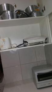 A kitchen or kitchenette at Paradise Thermas Residence