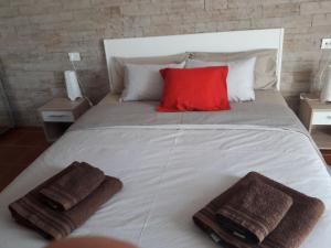 A bed or beds in a room at Lanzadream Apartments