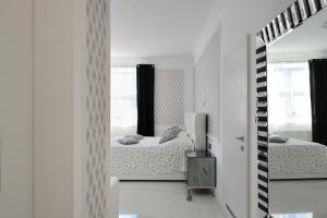 A bed or beds in a room at Apartment Sloapart