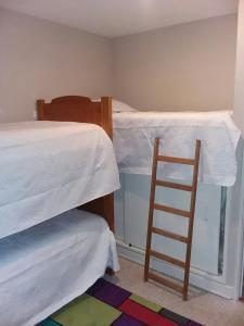A bunk bed or bunk beds in a room at San Alfonso Del Mar