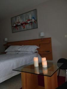 A bed or beds in a room at San Alfonso Del Mar