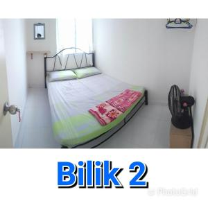 A bed or beds in a room at Apartment seri Ceria 1, Bukit Jalil