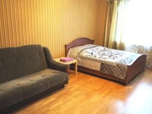 A bed or beds in a room at Apartments on Nadsonovskaya 24