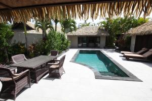 The swimming pool at or near Te Manava Luxury Villas & Spa