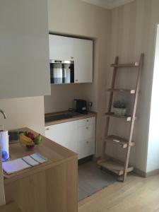 A kitchen or kitchenette at Appartamento Milano