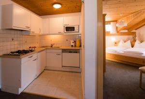 A kitchen or kitchenette at Appartamenti Olympic