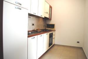 A kitchen or kitchenette at Residenza Naggi
