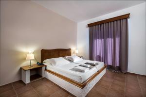 Ein Bett oder Betten in einem Zimmer der Unterkunft Olympia Mare